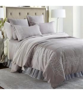 Le lenzuola grigio elegante ricamo