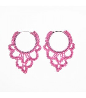 Special pink crochet earrings on a circle