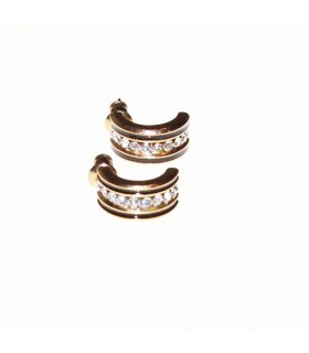 Golden elegant earrings with rhinestones
